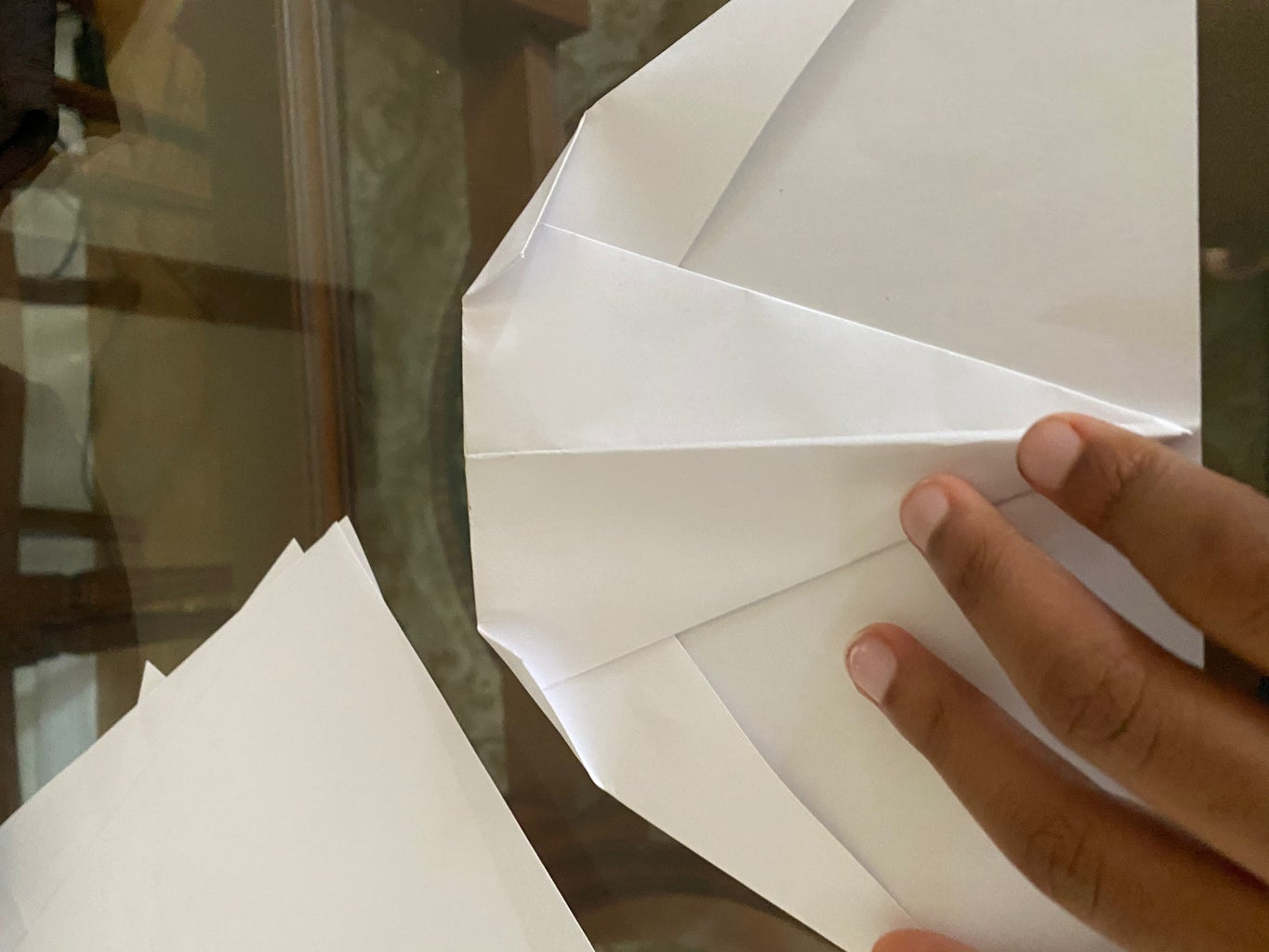 Step 10: Unfold and Tuck the Ends