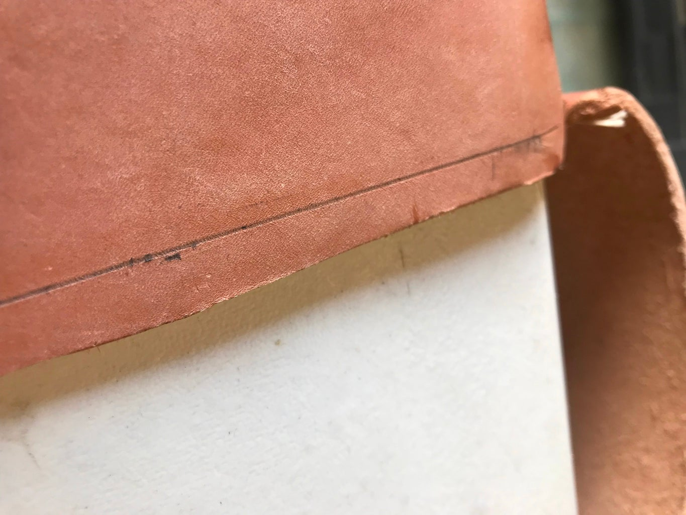 Punching and Sewing the Bottom of the Main Compartment