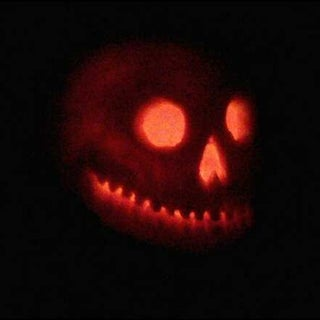 bas releif skull pumpkin illuminated.jpeg