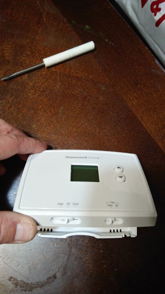 Remove Front Cover of New Thermostat