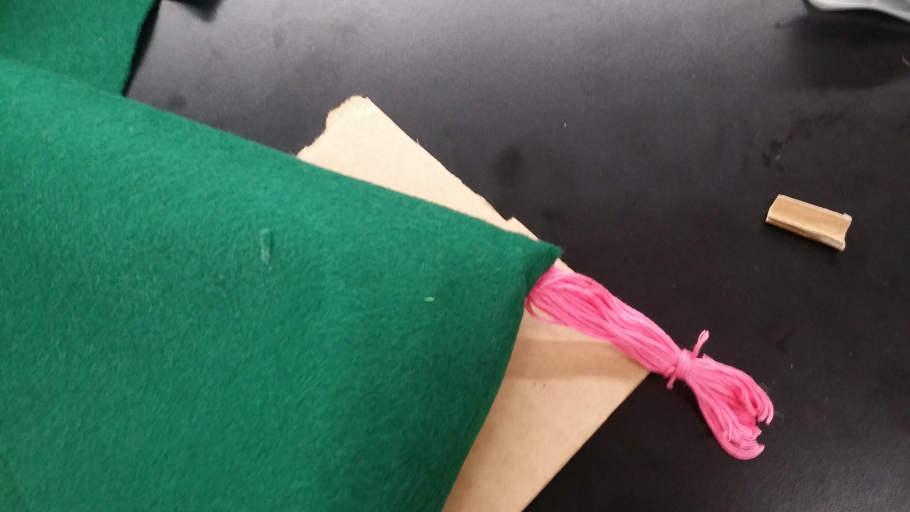 Put the Cardboard Inside and Attach the Thread to It