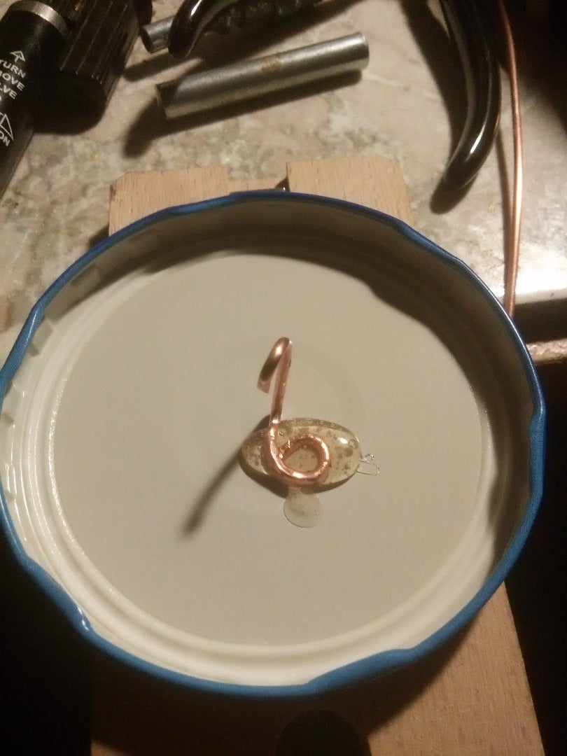 Hot Glue the Wire to Lid