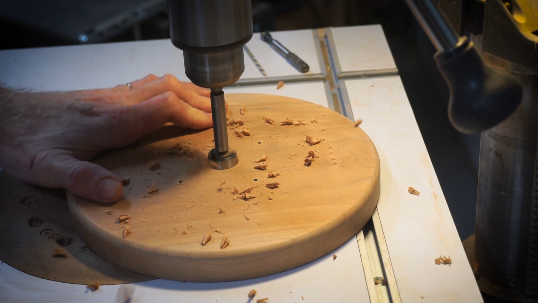 Drill a Larger Hole Into the Center of the Round Base