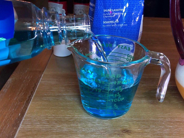 Measure Blue Mouthwash
