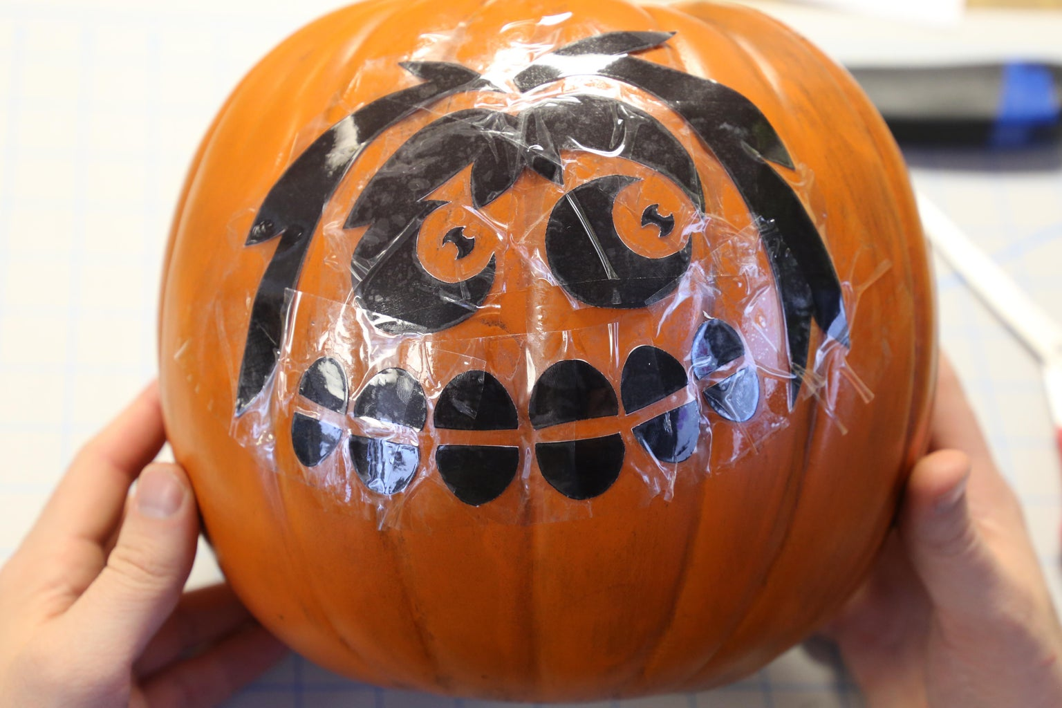 Tape the Pattern to Your Pumpkin