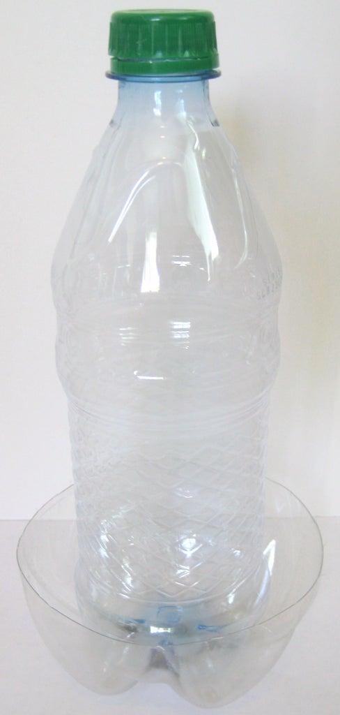 Secure the Small Bottle Inside of a 2-Liter Bottle