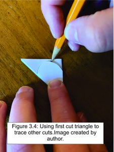 Use the Scissors to Cut the Folded Paper Into an Ice Cream Cone Shape.