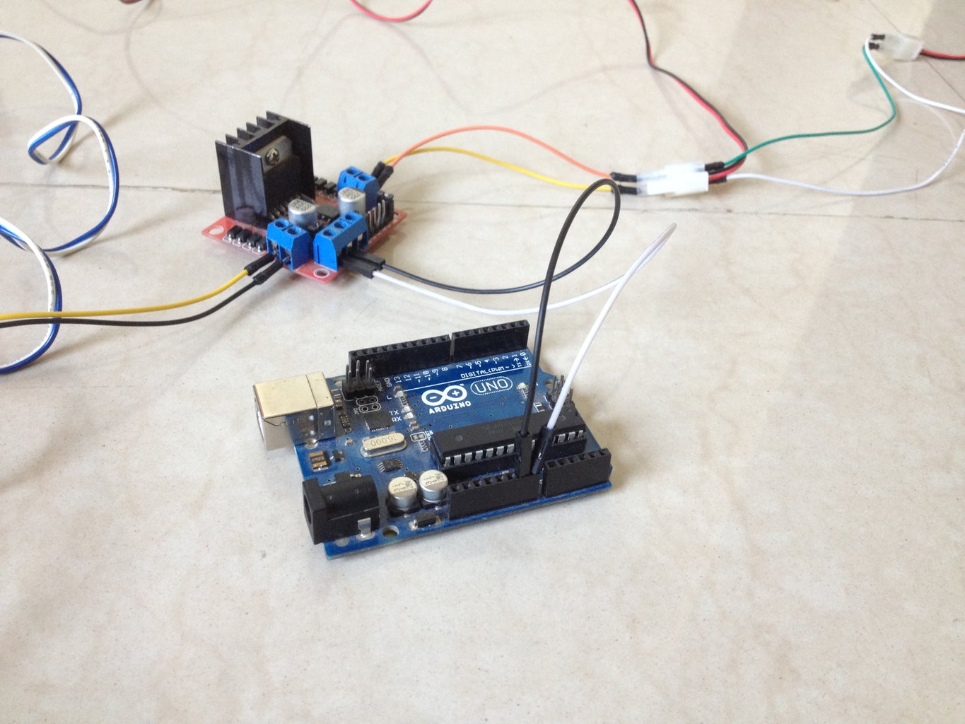 Connect the L298N Driver Board to the Power Pins of the Arduino Board