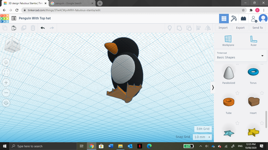Then Collect a Paraboloid From the Shape Tab and Colour It Orange. Using the Angle and Rise Tools, Shape the Paraboliod Onto to Penguin to Create a Beak.