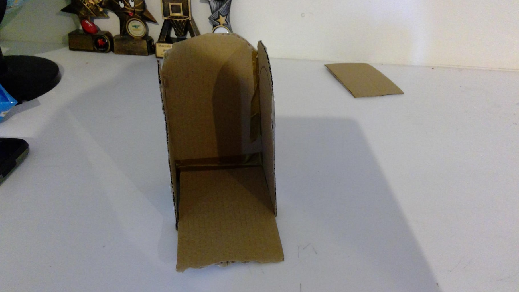 Cut a Cardboard Rectangle and Place It on a Slight Angle So That Ball Can Roll