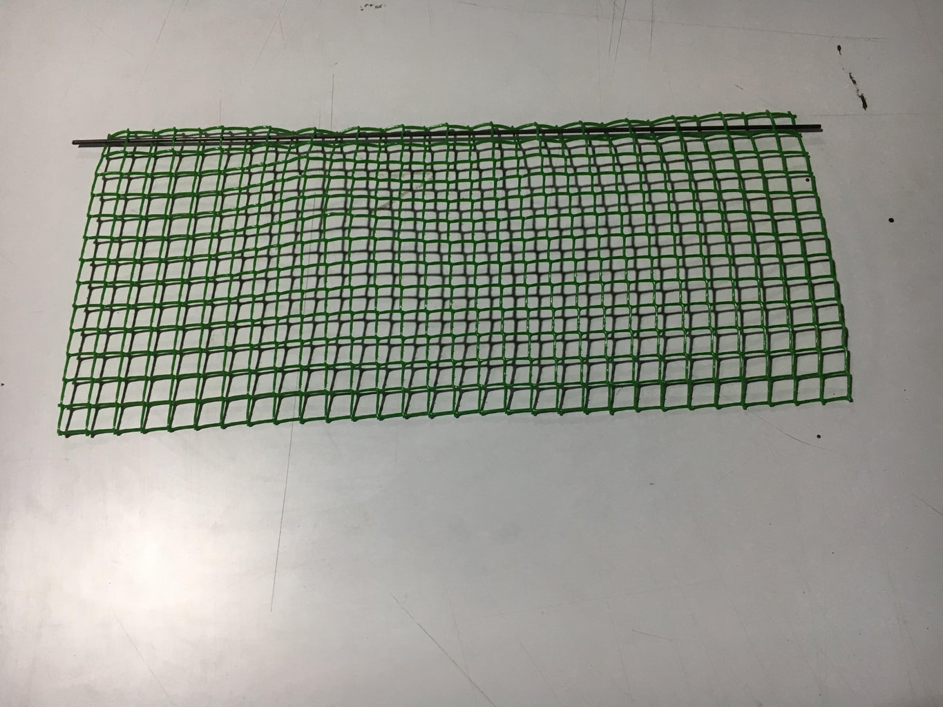 Insert the Metal Rods Through the Mesh.