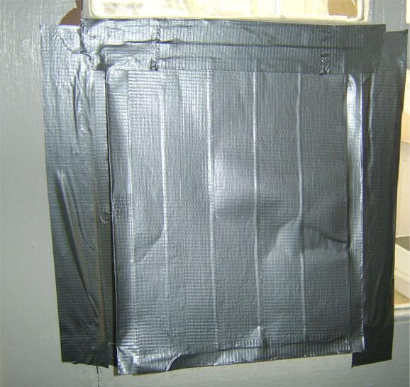 Make a duct tape pet door