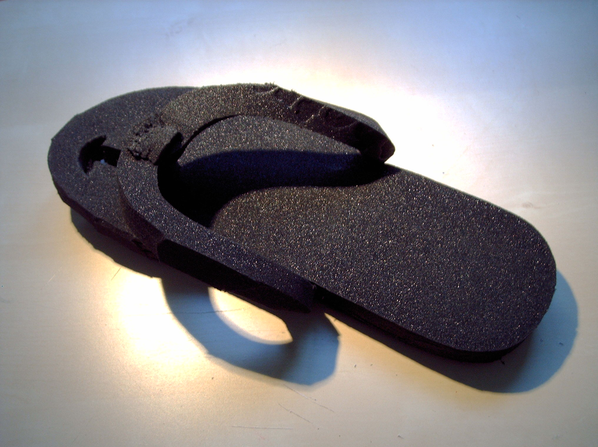 Improvised Flip Flops out of a camping mat