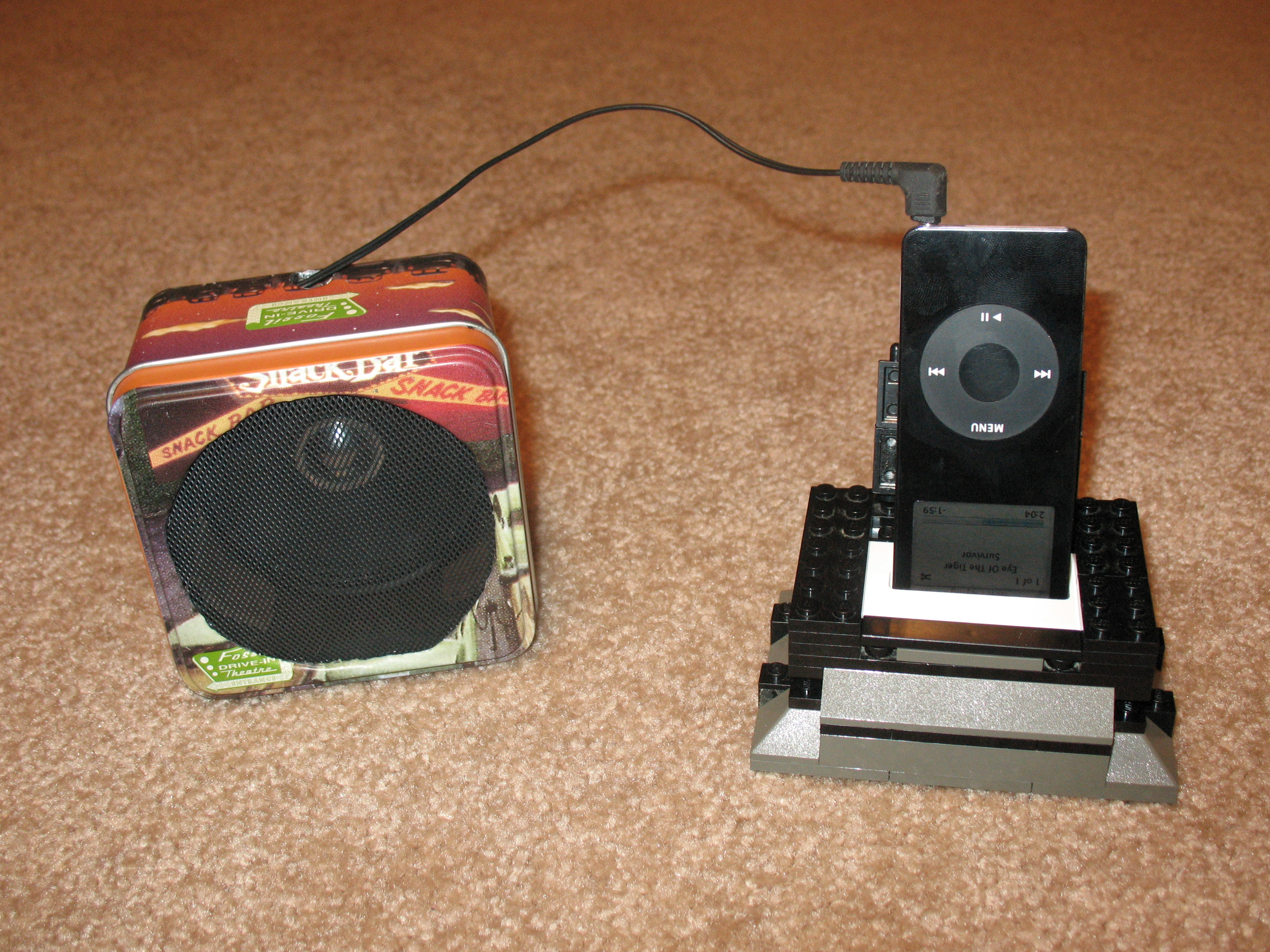 Speaker made from a fossil watch container (for an ipod)