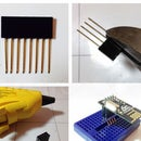 A simple hack to adapt an 8 pin male dual row header to a breadboard.