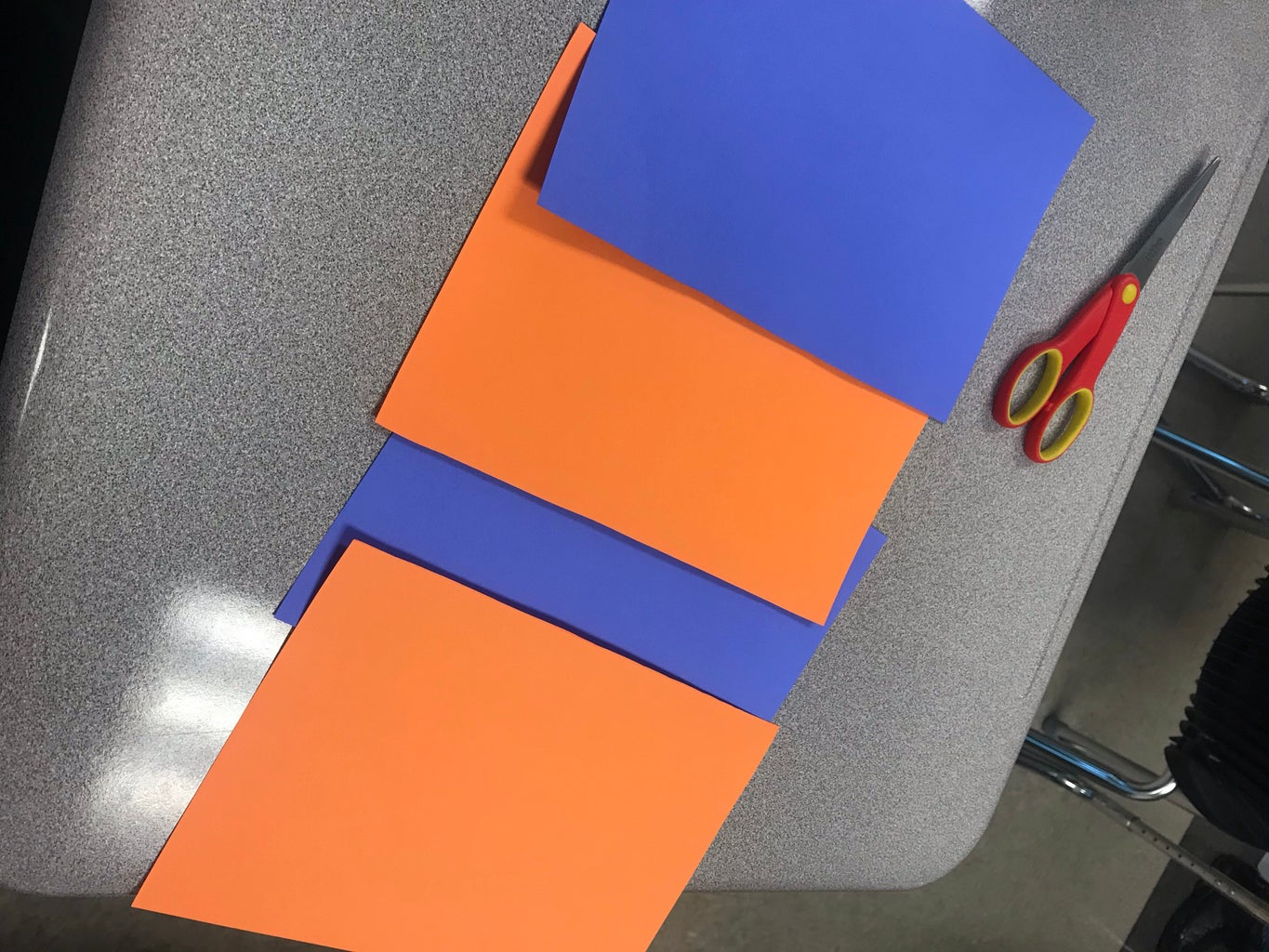 Cut Paper in Two From the Line