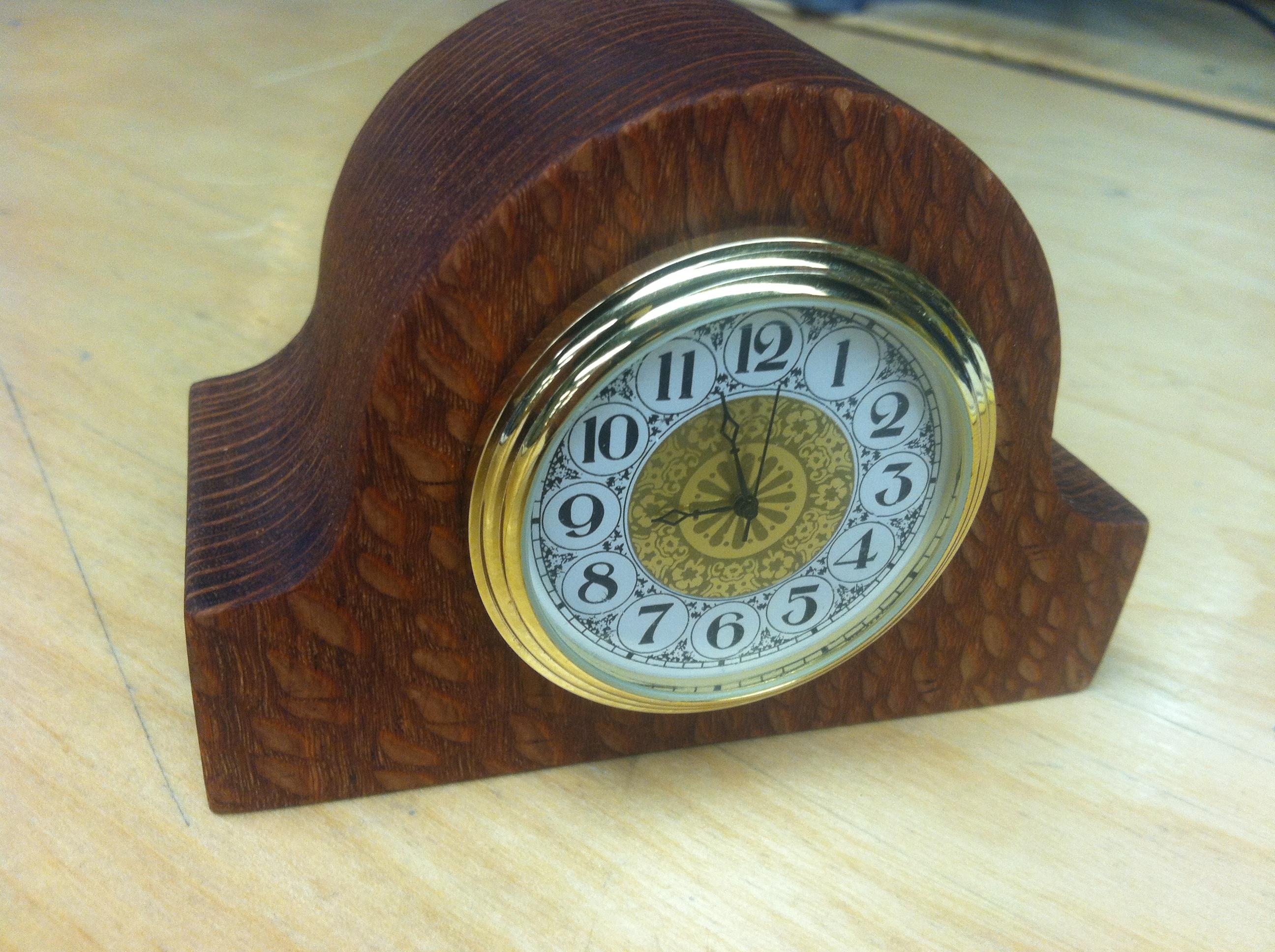 A mini tambour style desk clock