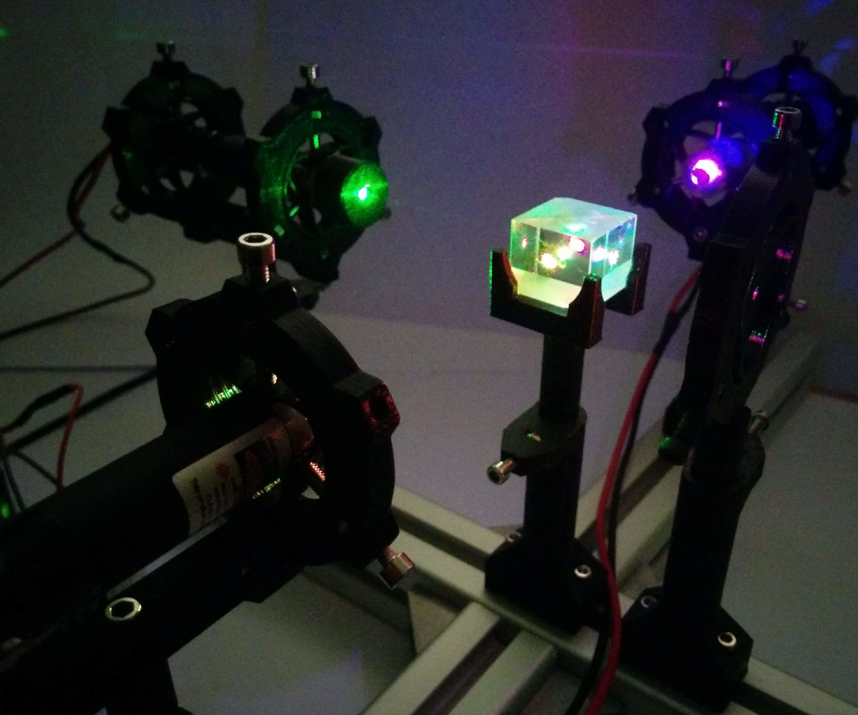 A Laser Beam Combiner With Parametric Optomechanical Components.