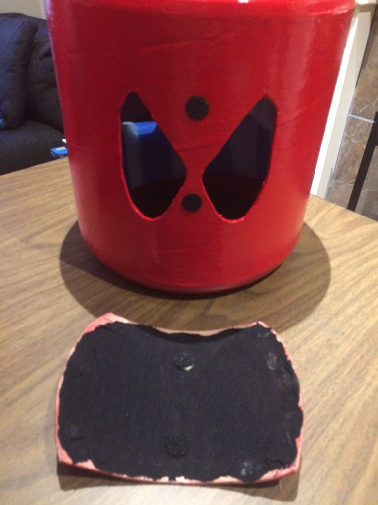 Attach Some Velcro Dots to the Mask and the Head.