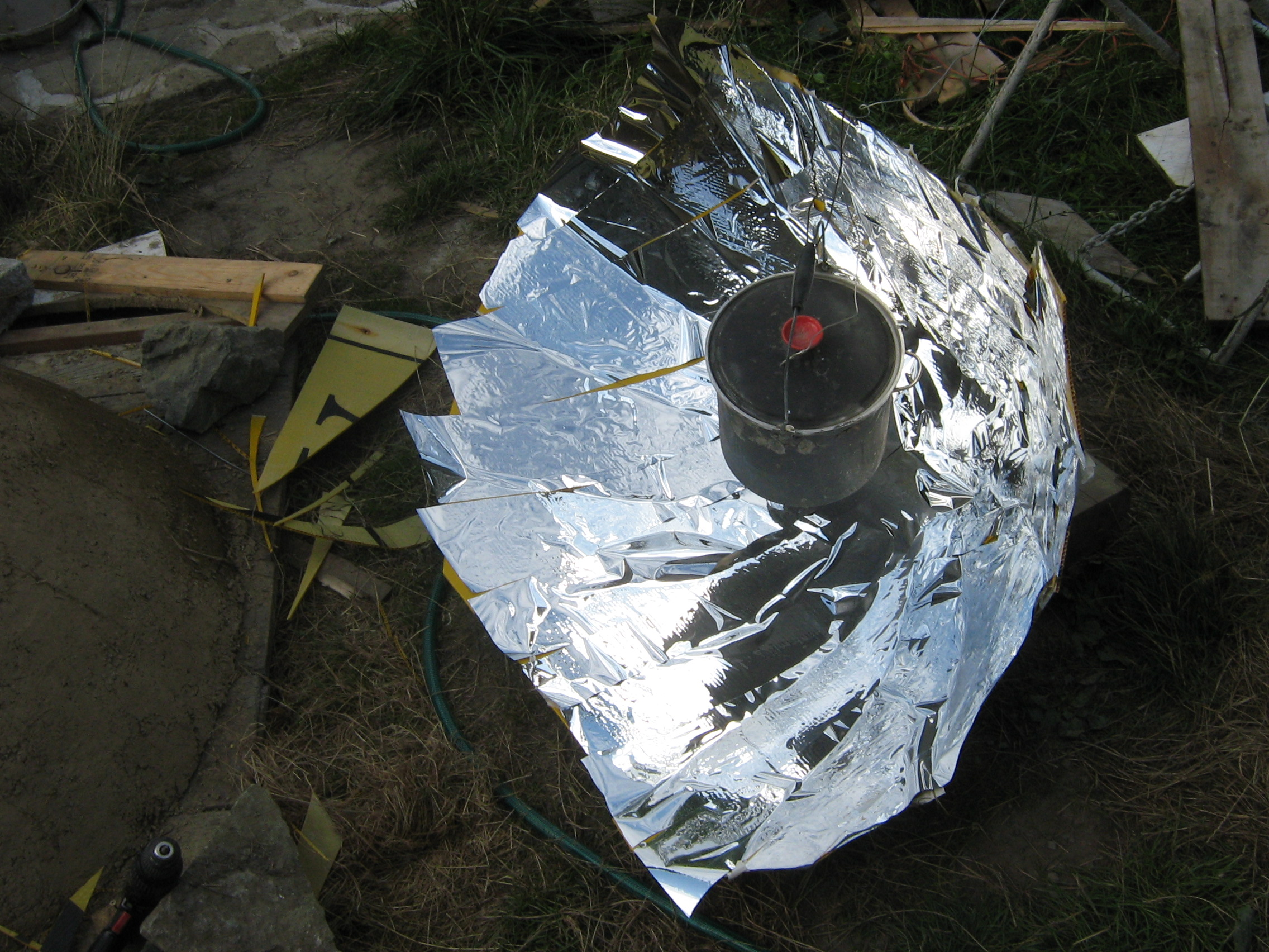 "Making and using  a ""compound"" parabolic solar cooker (Large project)"