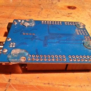 Hotgluing Erasers to an Arduino