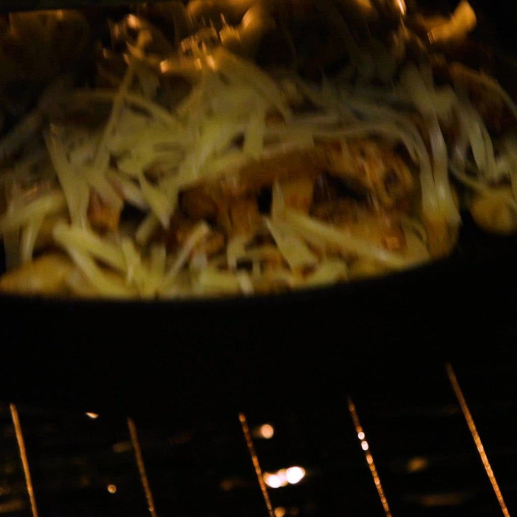 Spoon Over the Kimchi and Chicken Mixture and Top With Some Grated Cheese.
