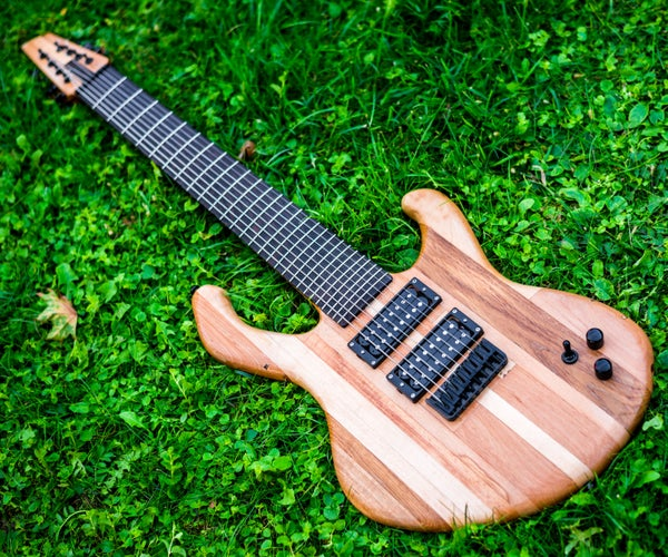 Hand Crafted Guitar From Recycled Wood