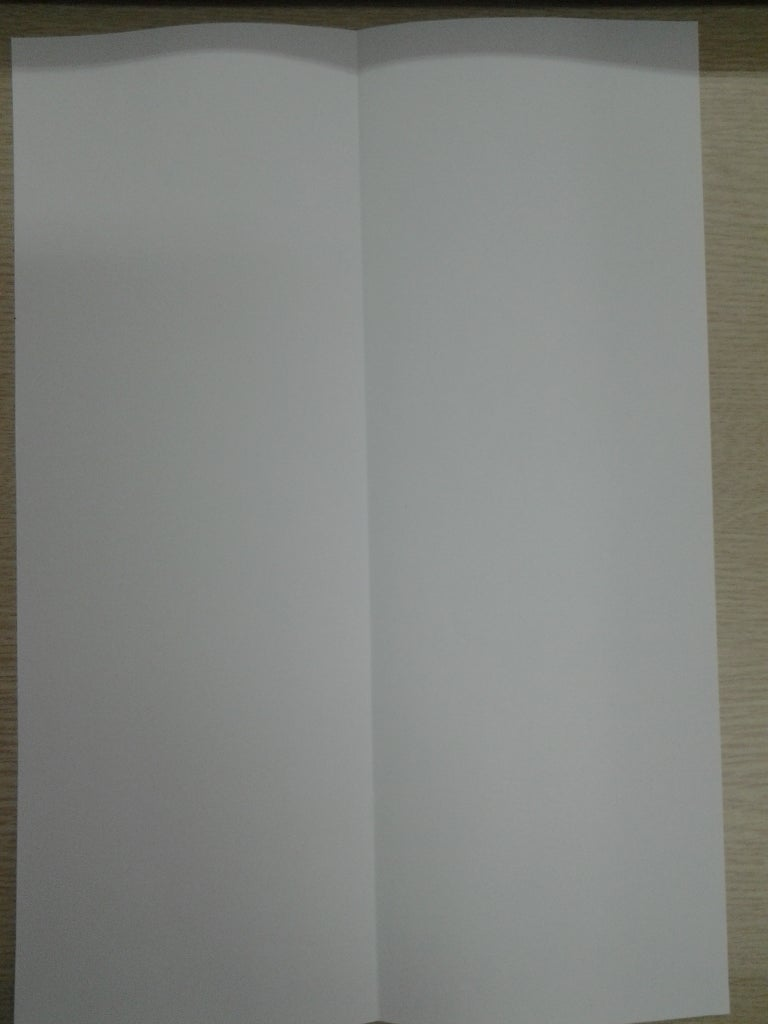 Fold the Paper in Half Longways.