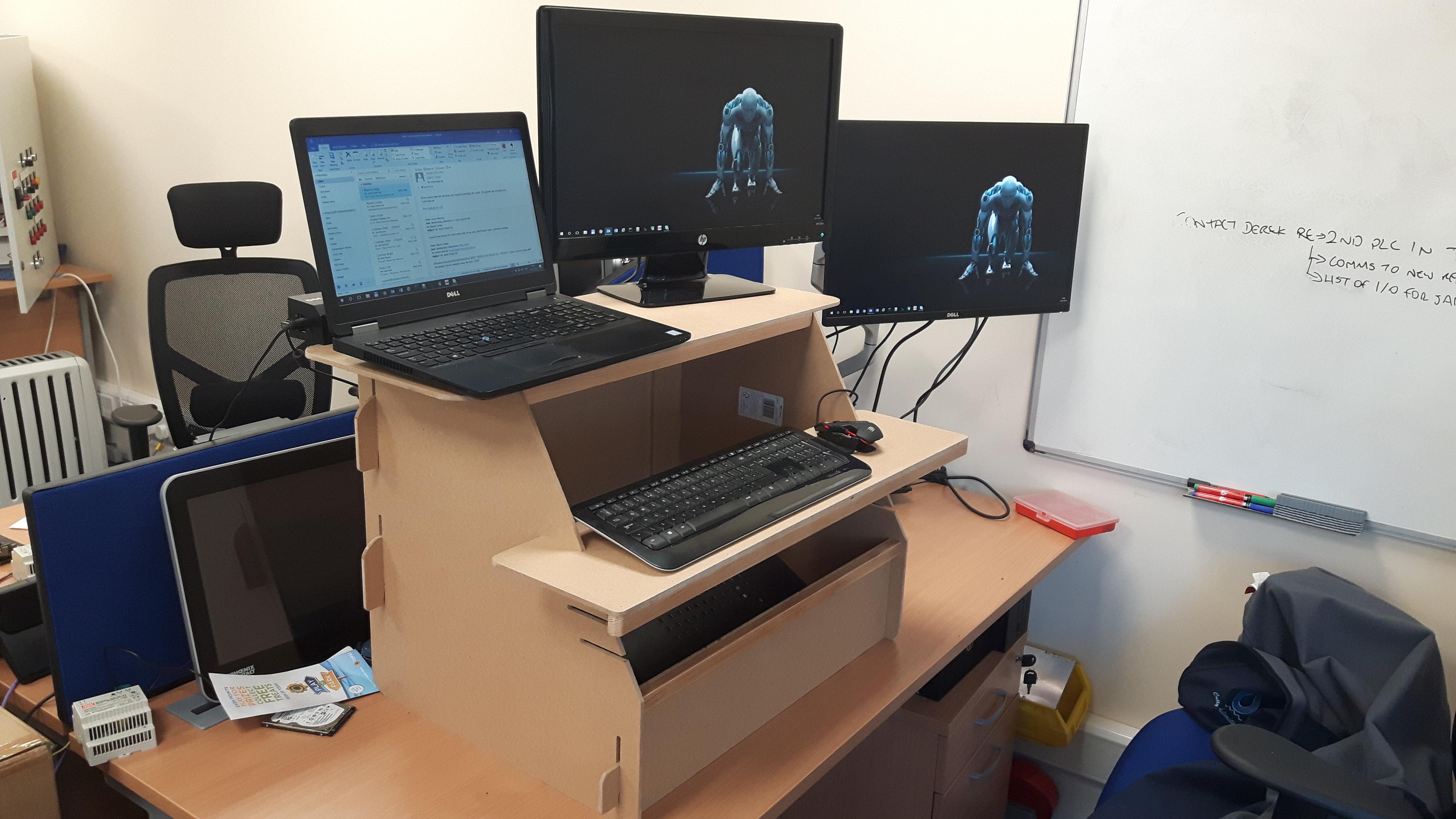 Sitting to standing desk converter