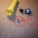 $1 to repair your flashlight and get a bonus FM radio receiver.