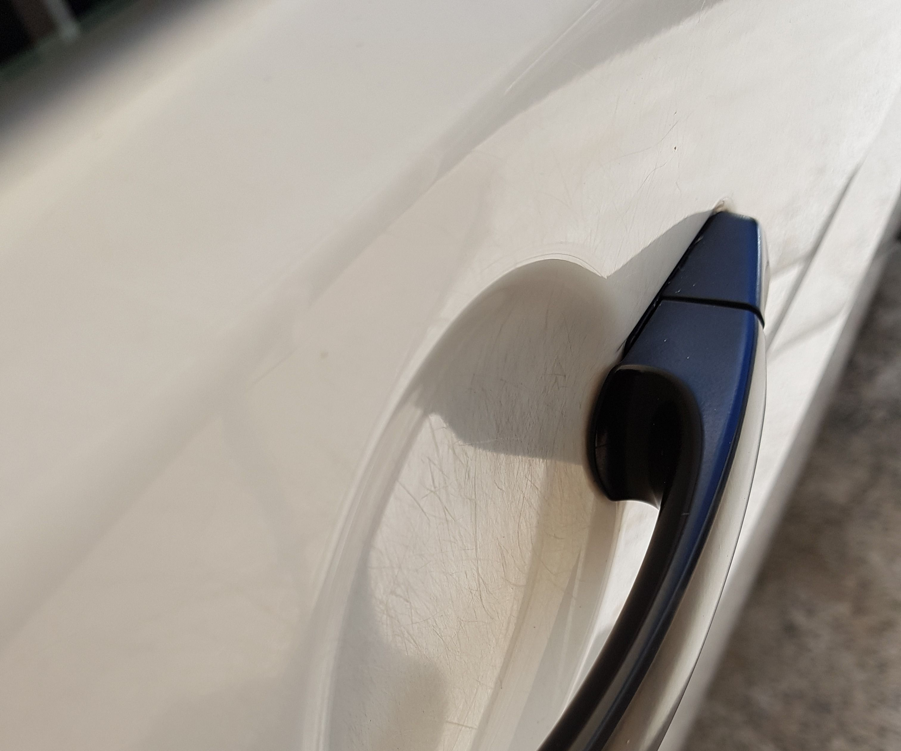 How to Polish Scratches From Under Your Car Door Handles