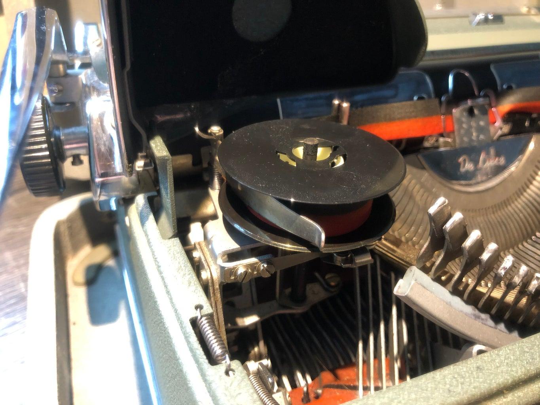 Removing Ribbon Spools From Typewriter