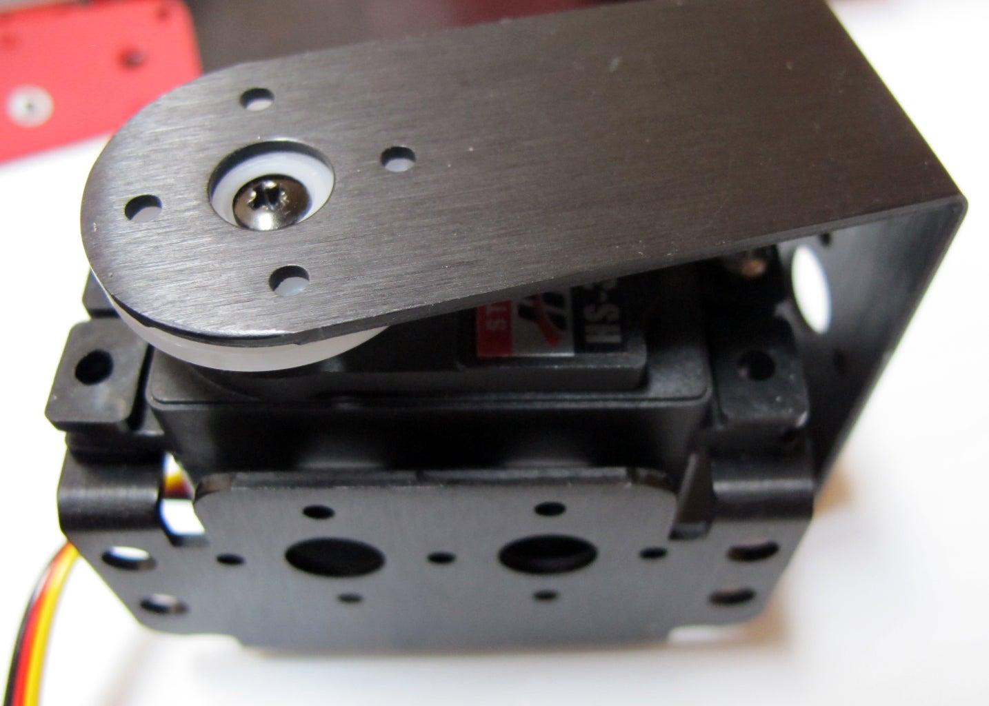 Prepare the Frame: Mount the C-bracket Pairs to the Servo Brackets