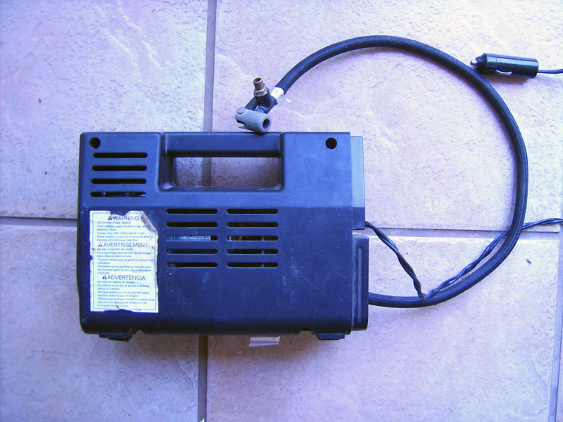 convert a tire inflator-type air compressor into a vacuum pump