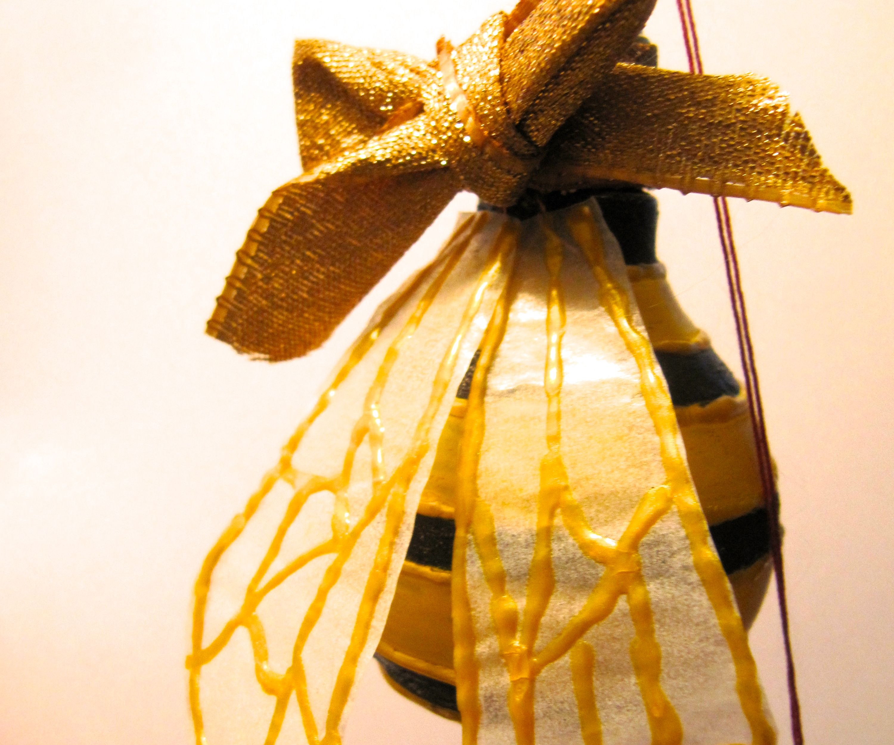 Bee Christmas bauble out of lightbulb