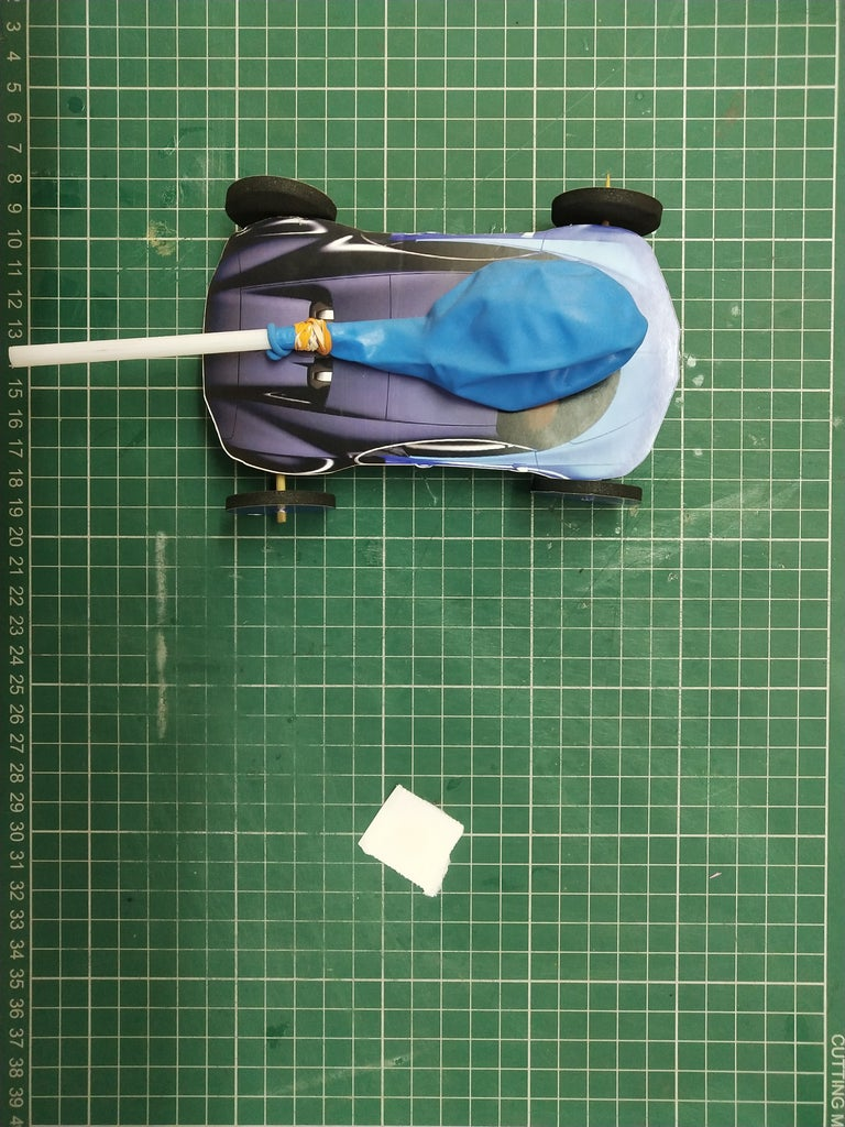 Paste the Balloon With the Model Car and Blow Air Into It