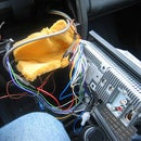 Add an auxiliary (MP3/Ipod) input to your car's stock radio