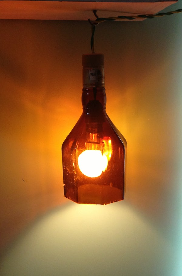 Hanging Lamp With an Empty Whisky Bottle