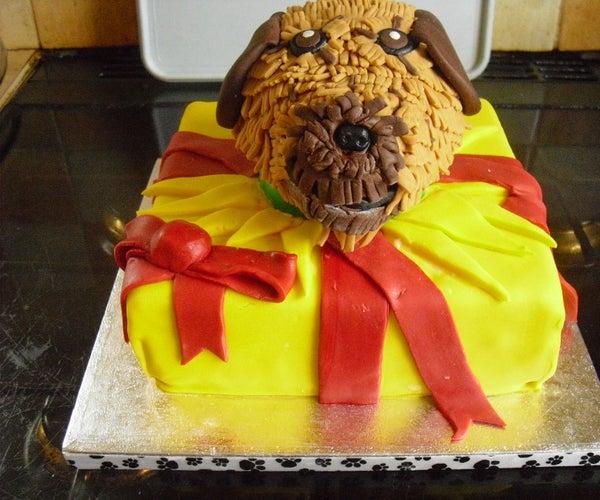 Dog in Present Cake