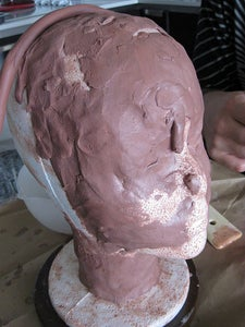 Mold the Clay Onto the Foam Head