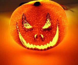 Halloween Orange Laser Etched Into a Glowing Mini Pumpkin