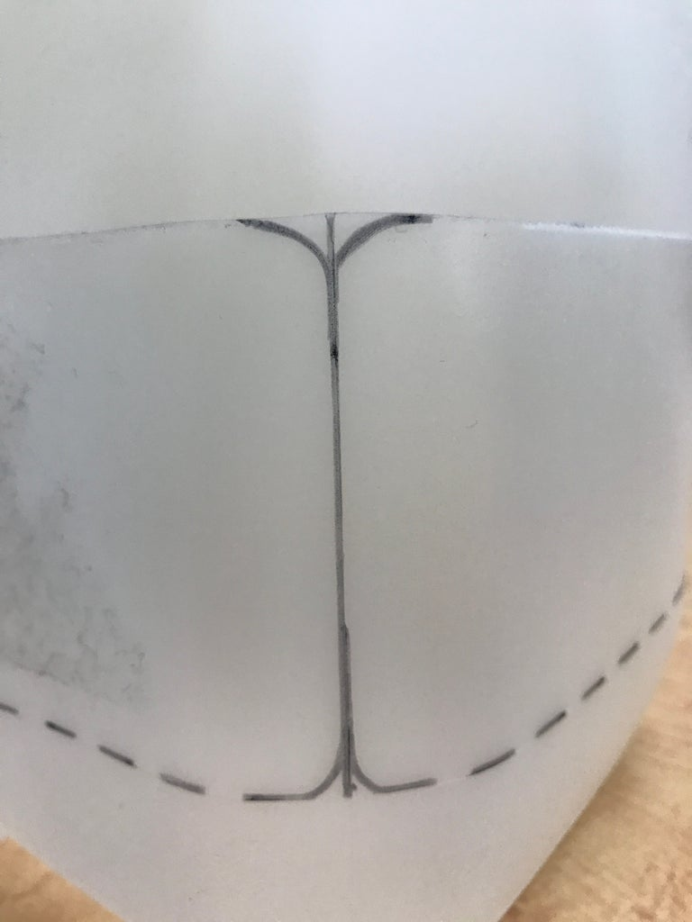 Trace Marks Where the Two Flaps Will Be and Cut Along the Solid Lines
