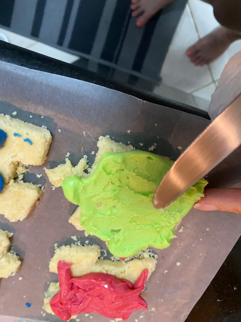 Spreading the Frosting Onto the Cookies