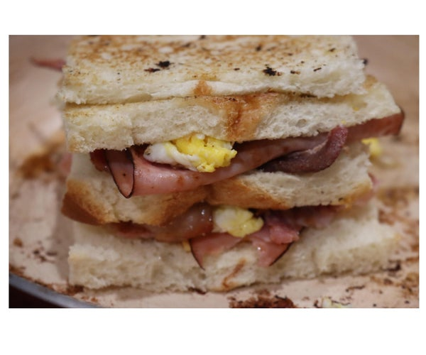 Toasted Sandwich With Ham, Bacon, Cheese, and Egg