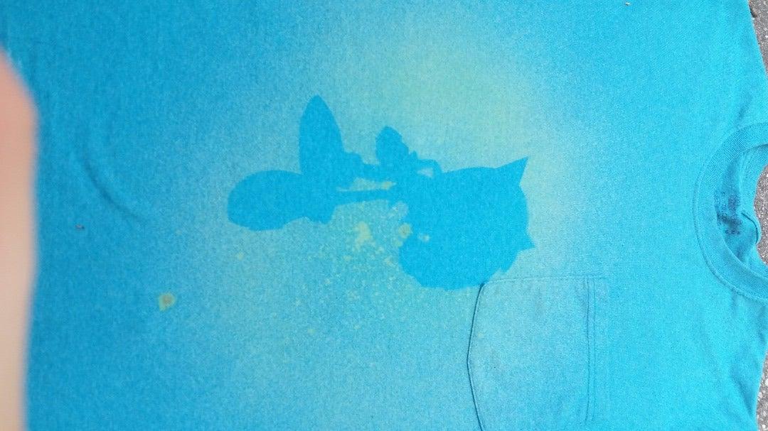 Spraying Bleach to Create Silhouette T-Shirts