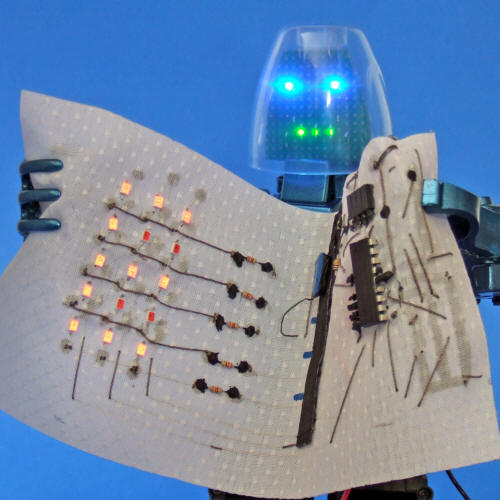 Conductive Glue And Conductive Thread: Make an LED Display and Fabric Circuit That Rolls Up.