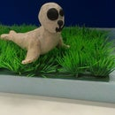 How to keep clay creations still on fake grass