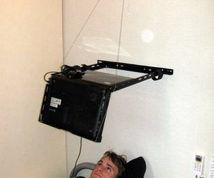 Laptop Mounted on Wall Above Bed