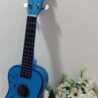 Make a Baritone Ukulele From a $10 Toy Guitar