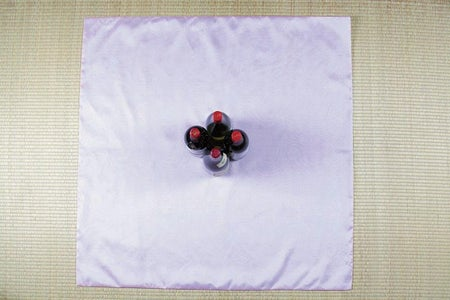 Place the Four Bottles at the Center of the Bojagi in the Shape of a Diamond.